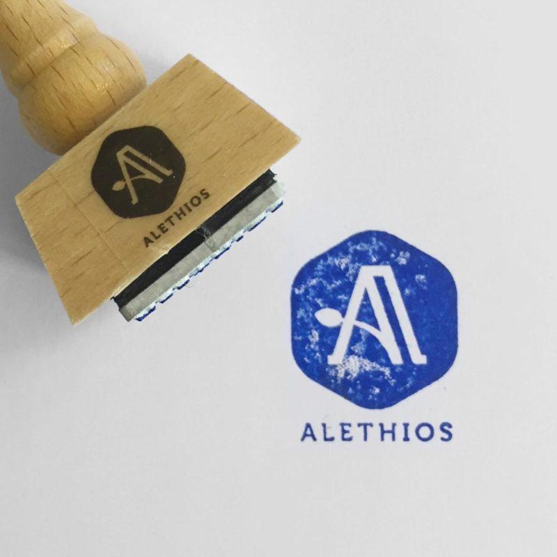 Alethios Logo Stempel MHG Bern